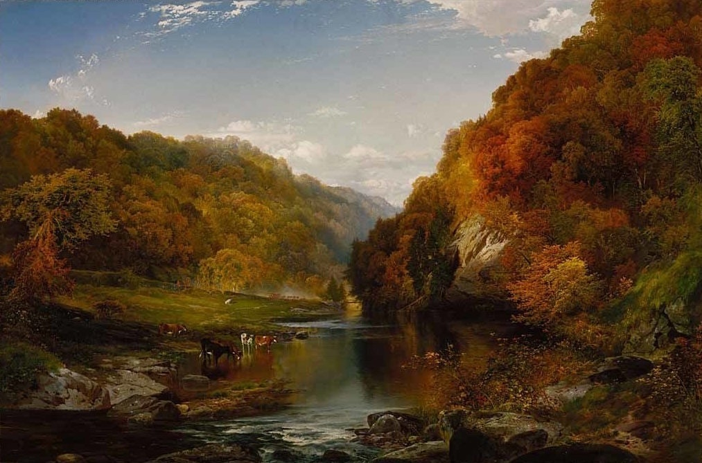 A richly colored painting of an autumn scene. Cows drink from a river surrounded by a lush forest of trees that have turned red, orange, and yellow.