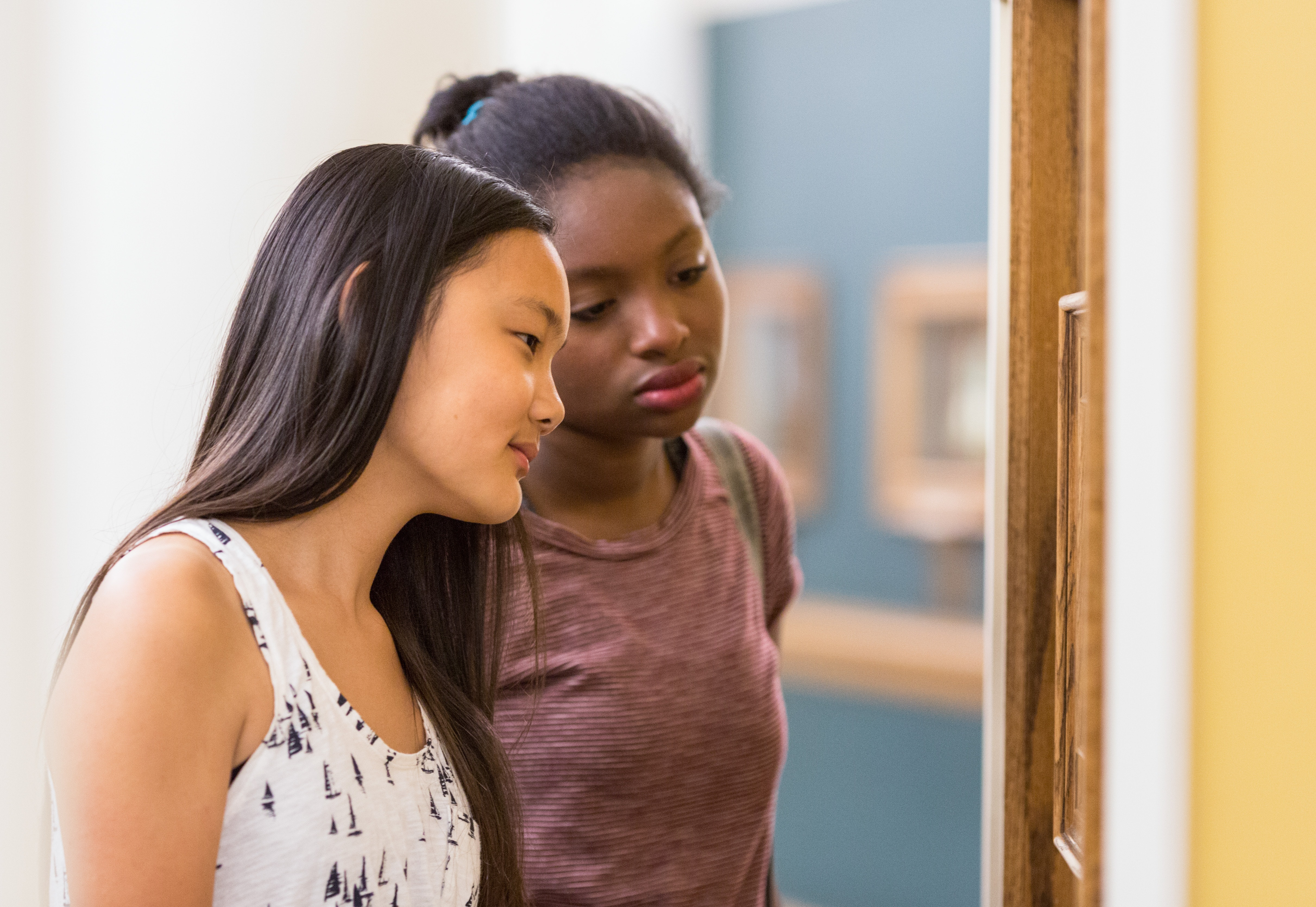 Two teen visitors look into a Miniature Room