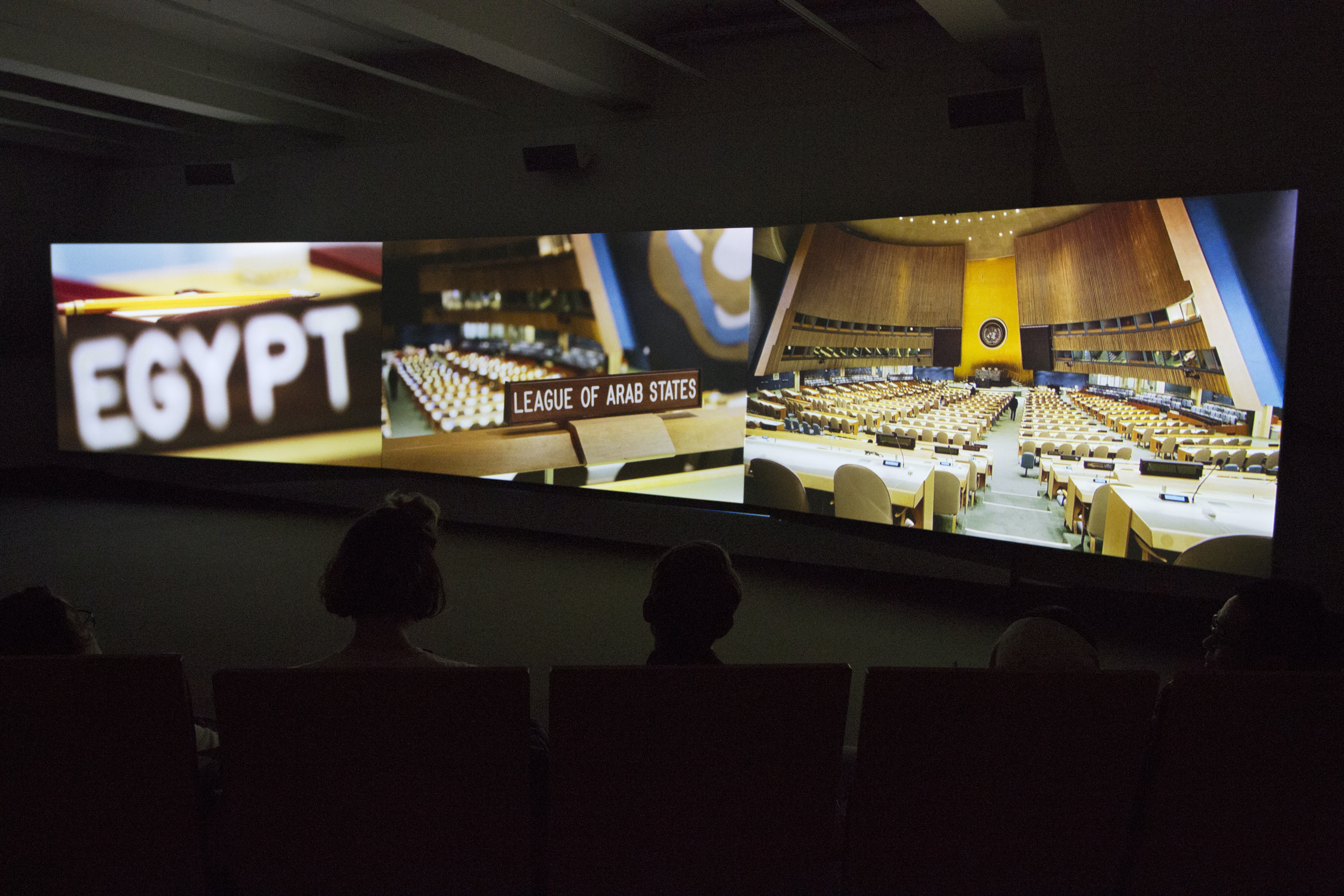 An installation view of a three-channel film