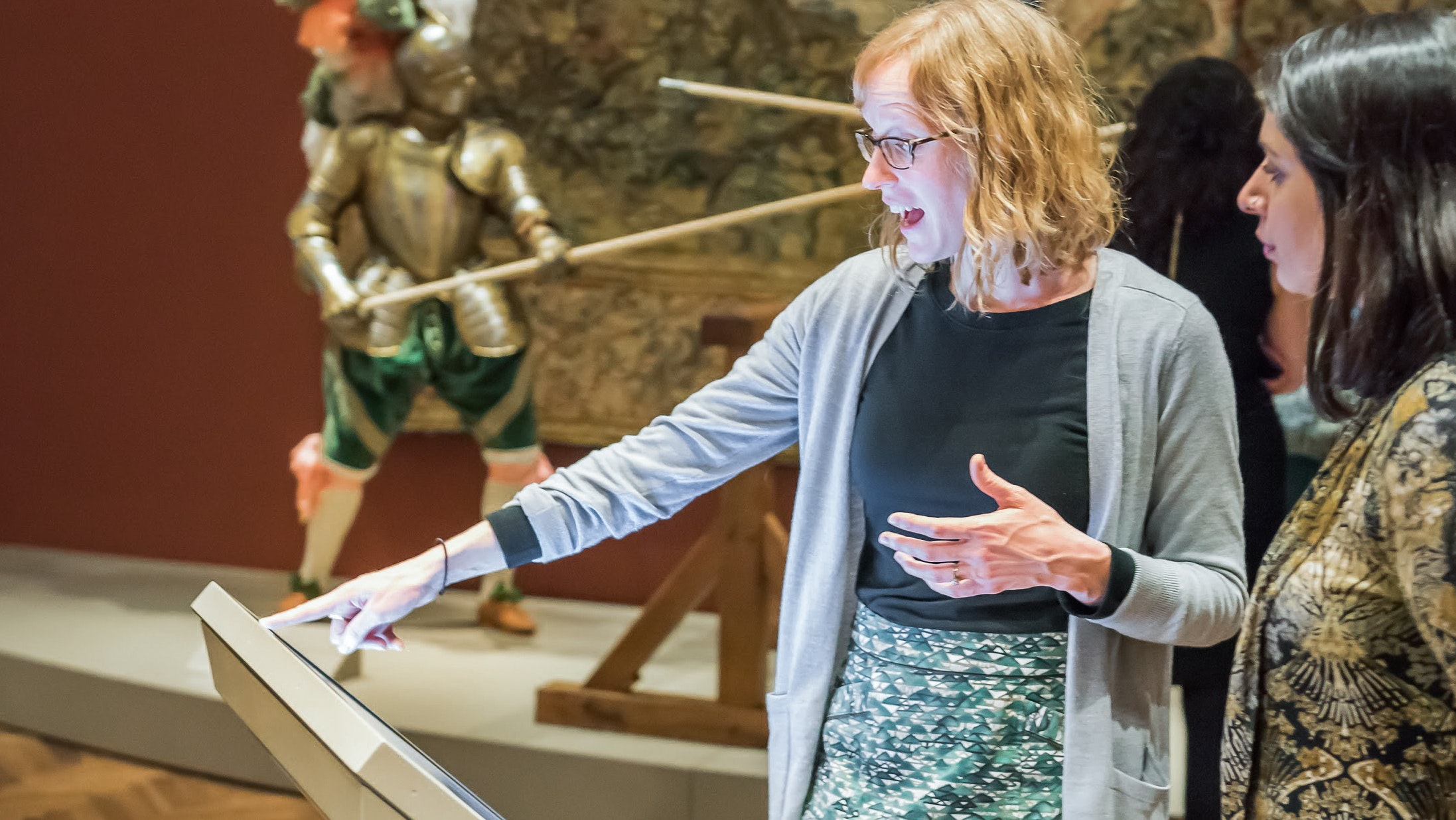 Two women interacting with a touch screen in the Medieval to Renaissance galleries