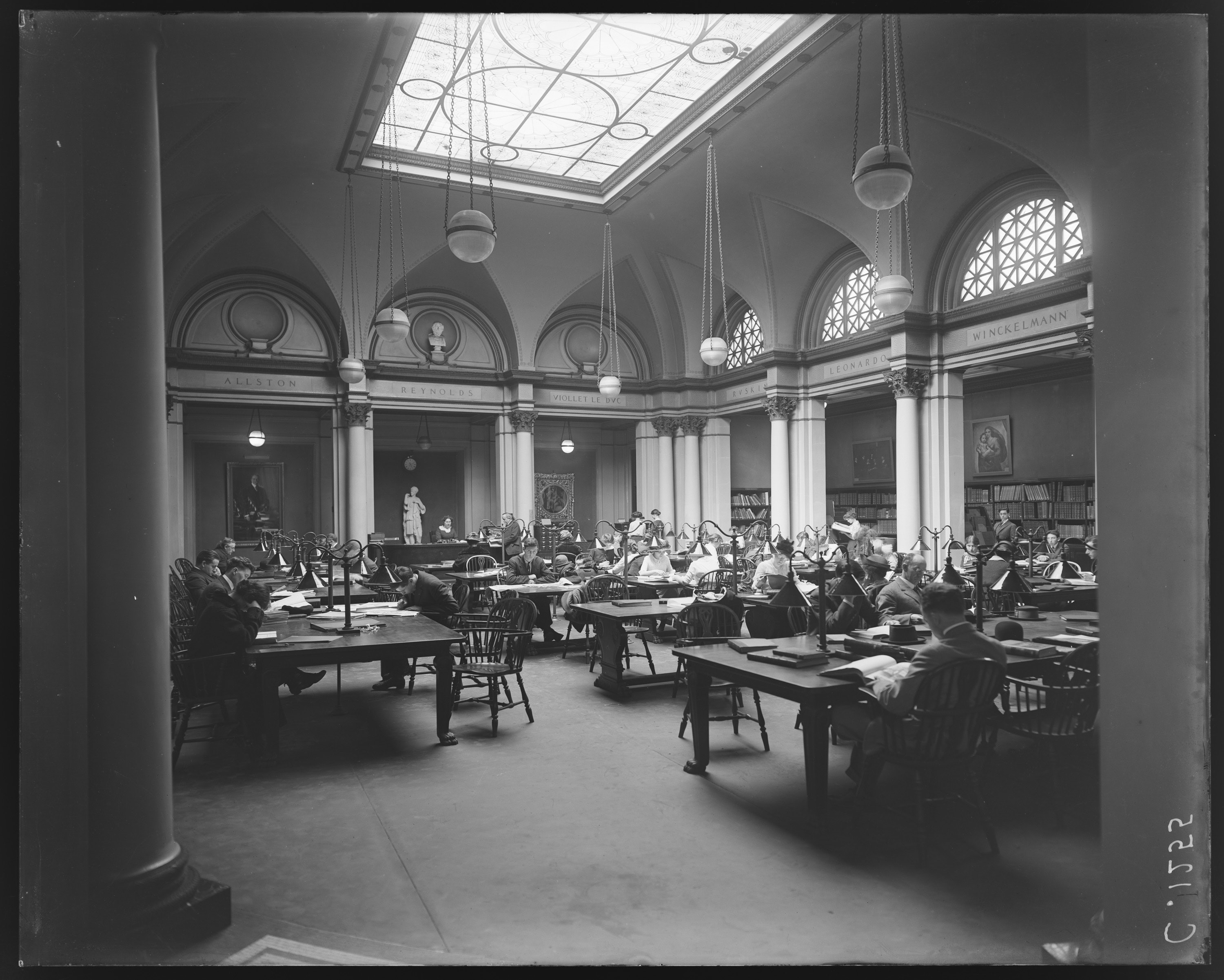 Old photo of patrons in the Ryerson and Burnham libraries