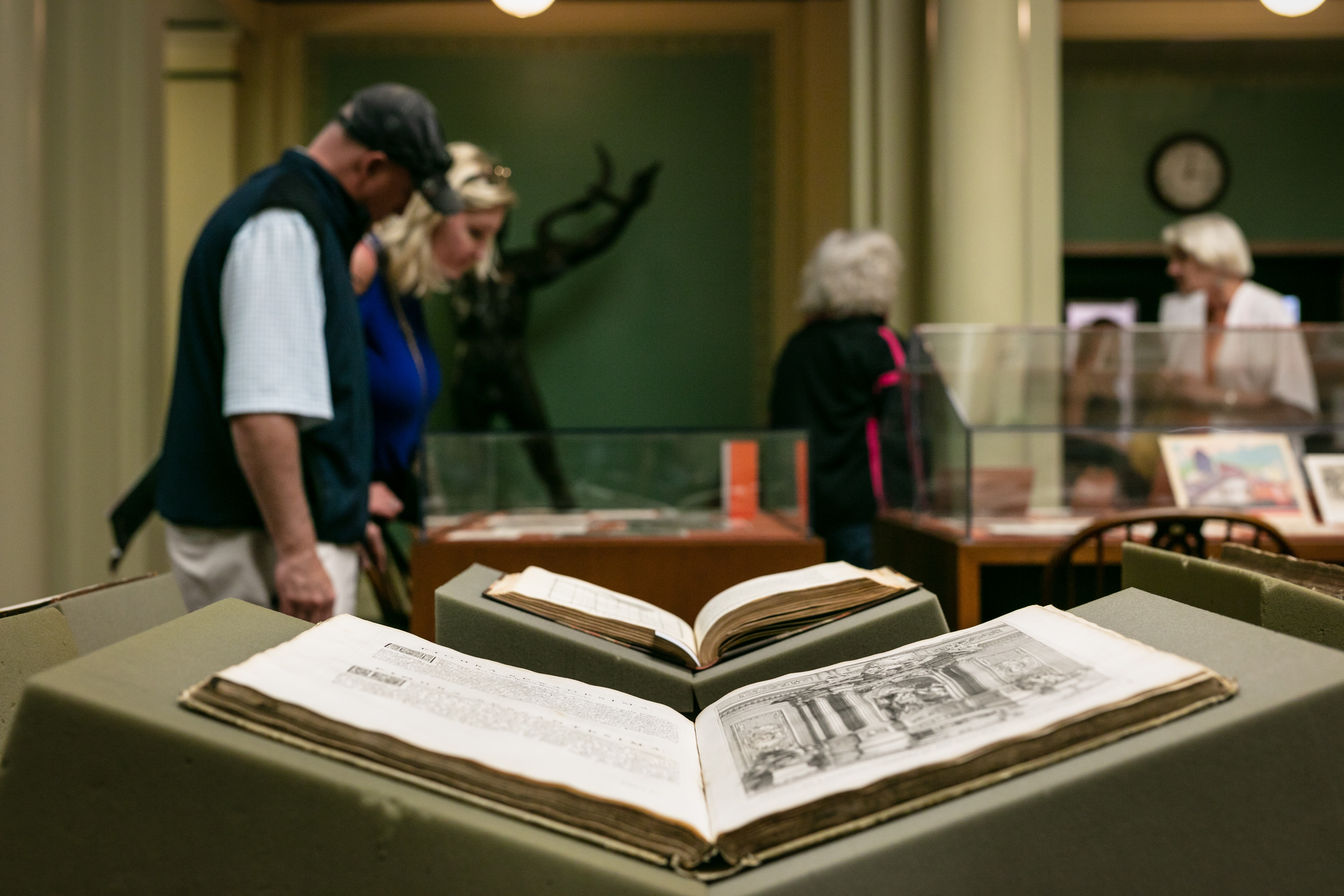 Two books from the special collection of the Library are displayed for visitors.