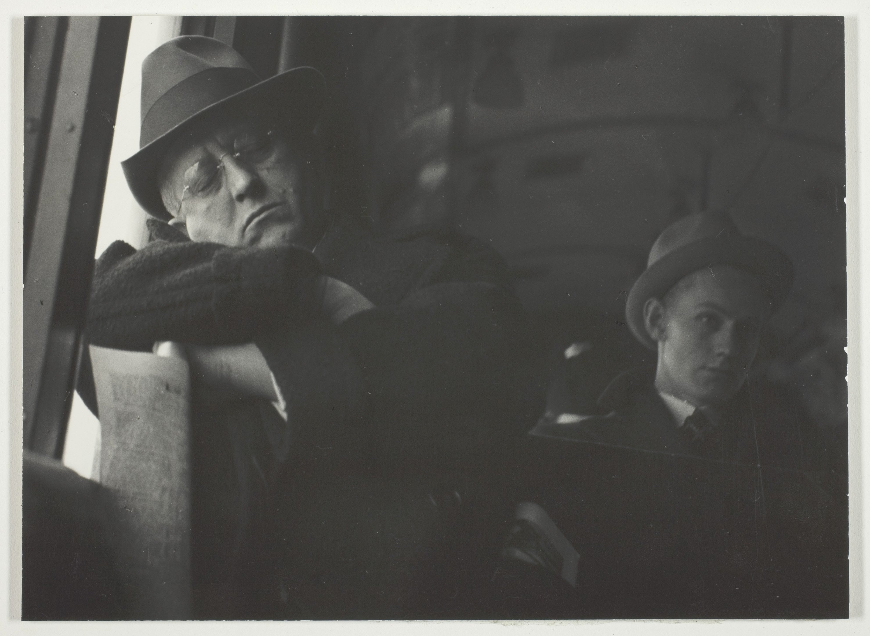 A man sleeps on a bus.