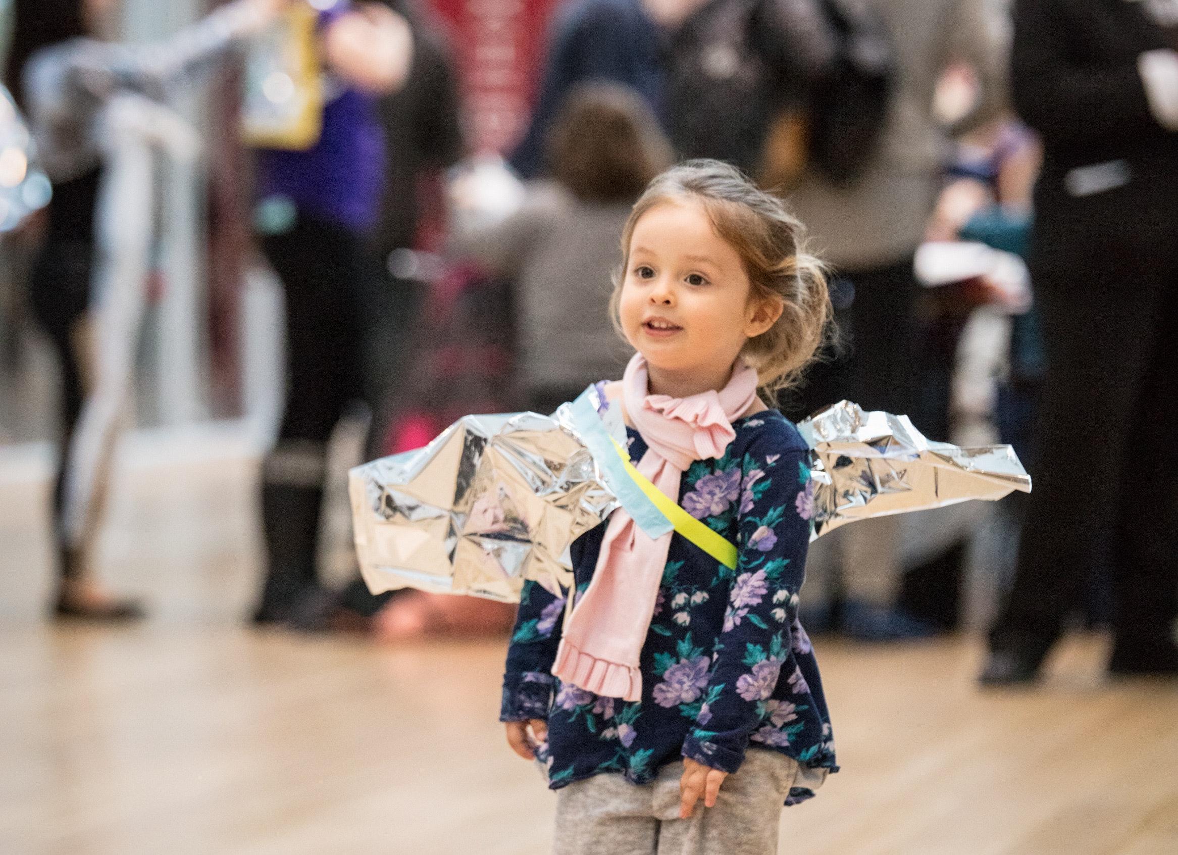 Child walking through galleries.