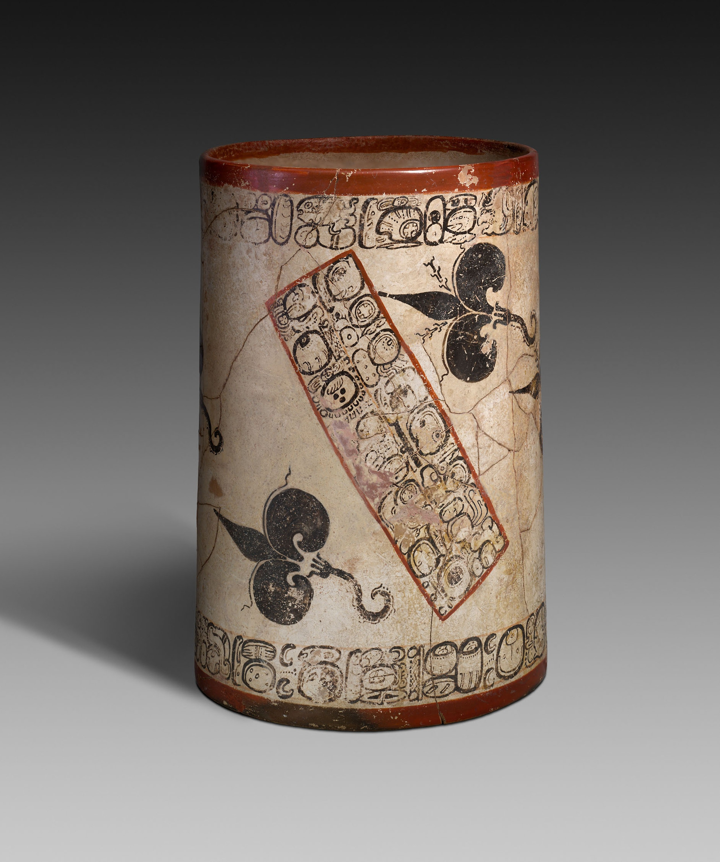 A vessel with water lilies and delicate inscriptions painted by Ah Maxam.
