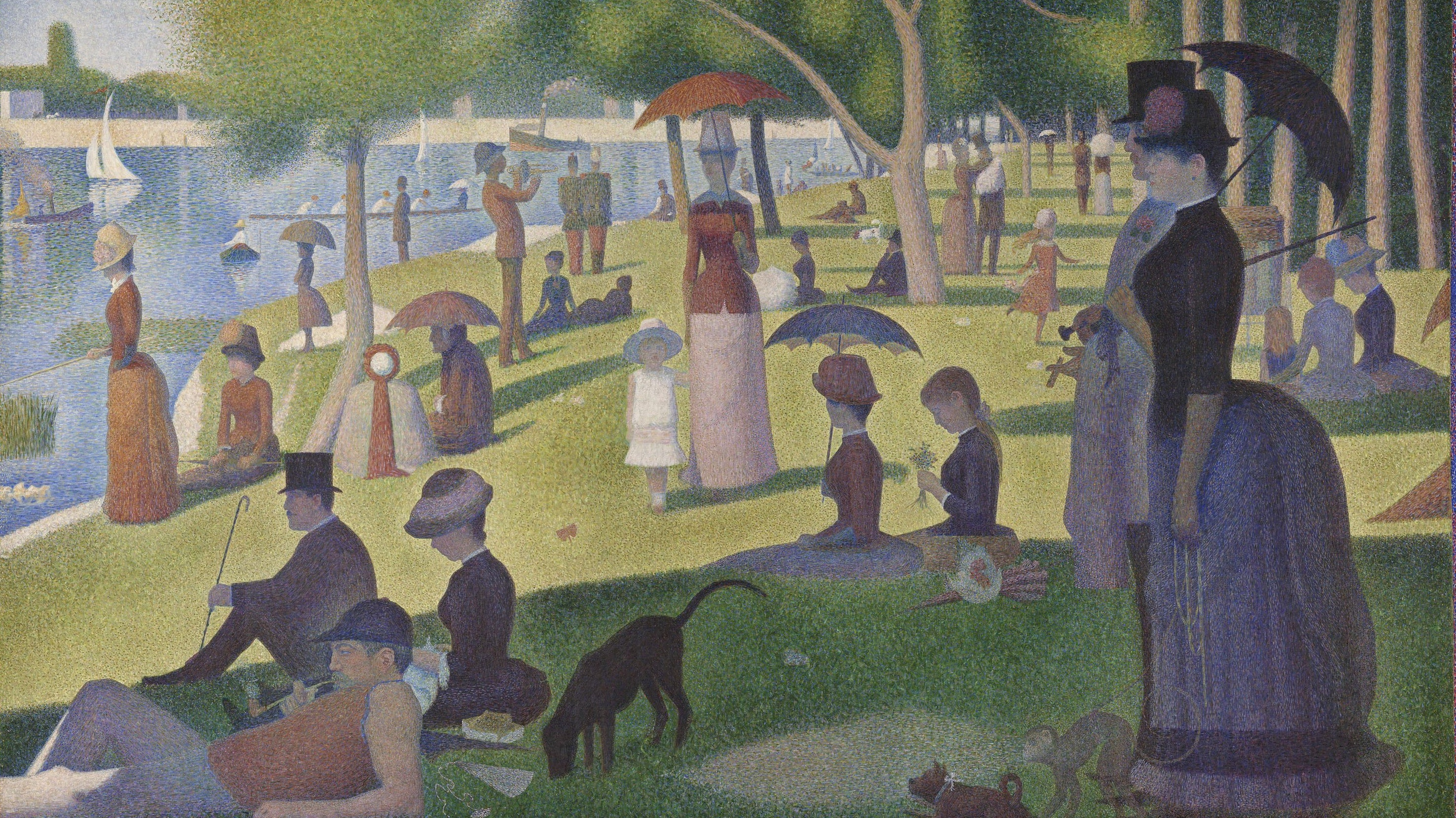A scene of many people at a park looking at a body of water.