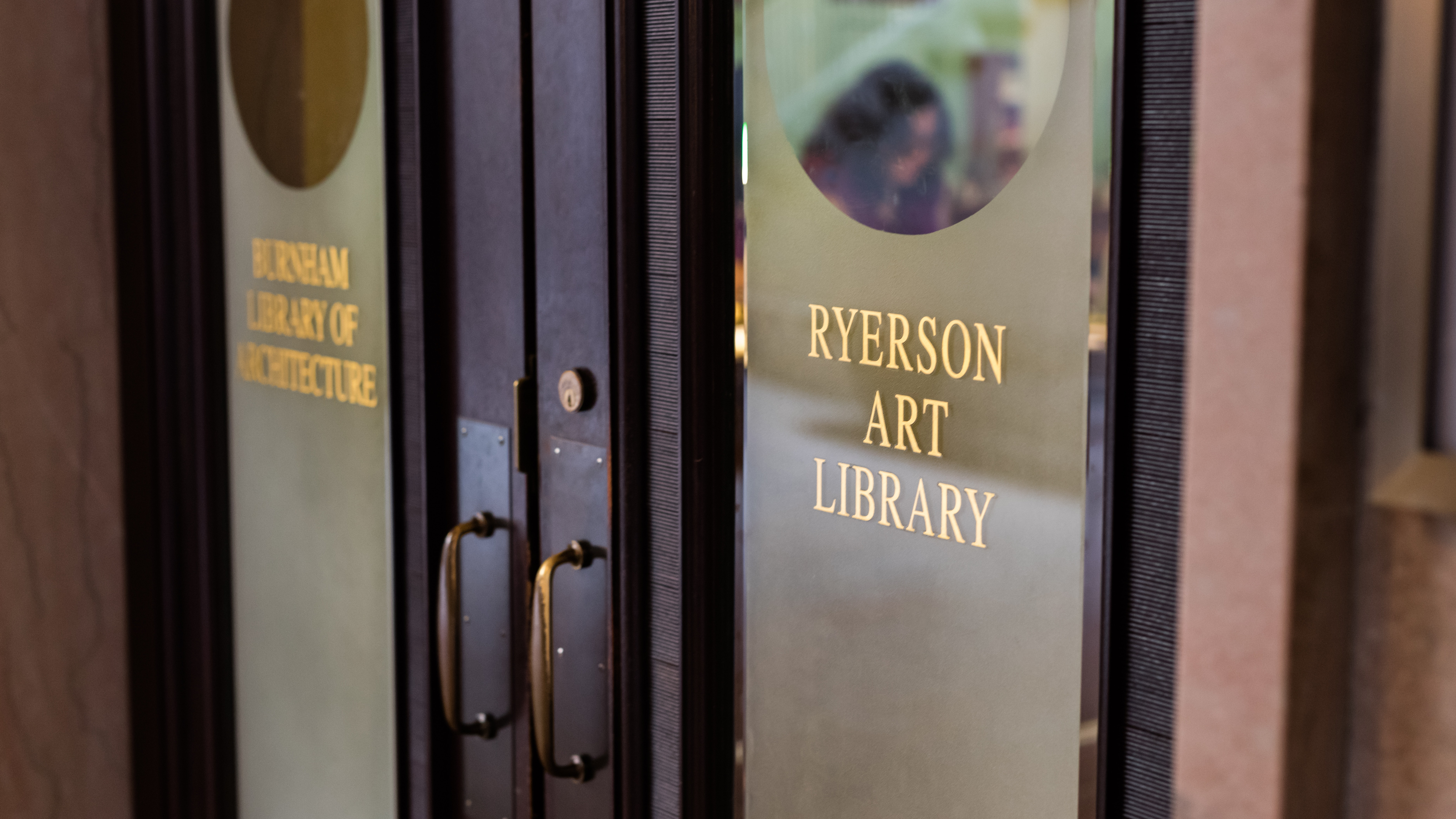 "Image of wooden doors with glass windows with words ""Ryerson Art Library"""