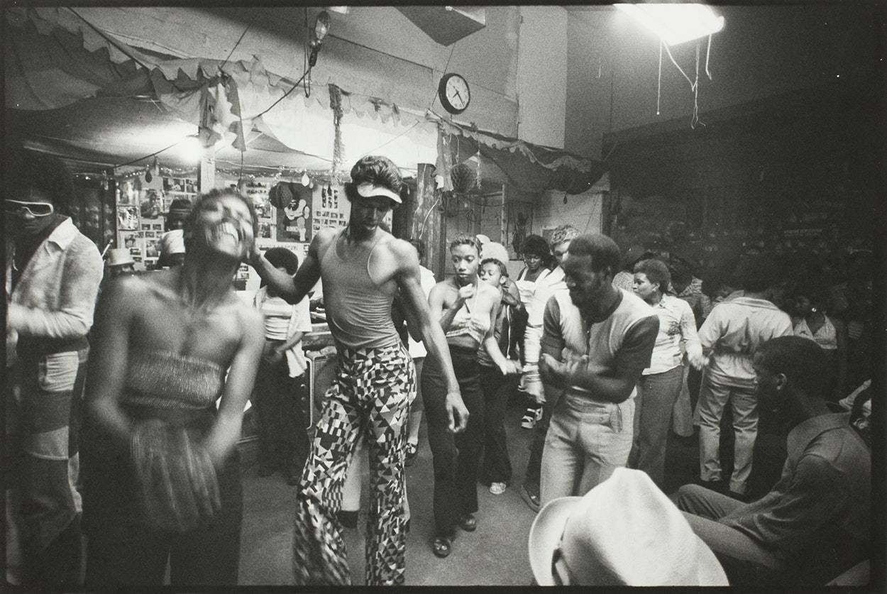 Black and whilte photograph of people dancing inside the Garage.