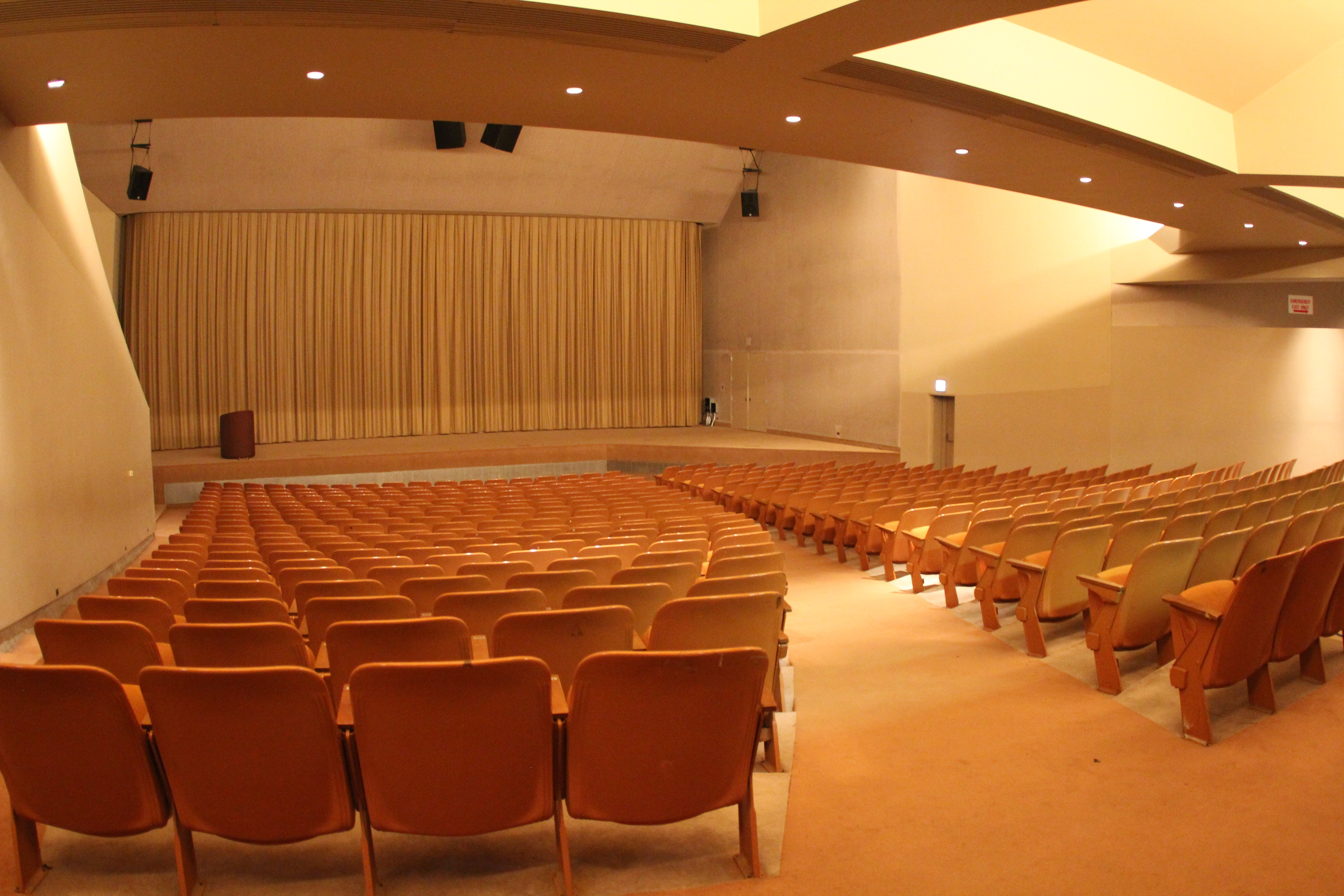Large auditorium with orange seats