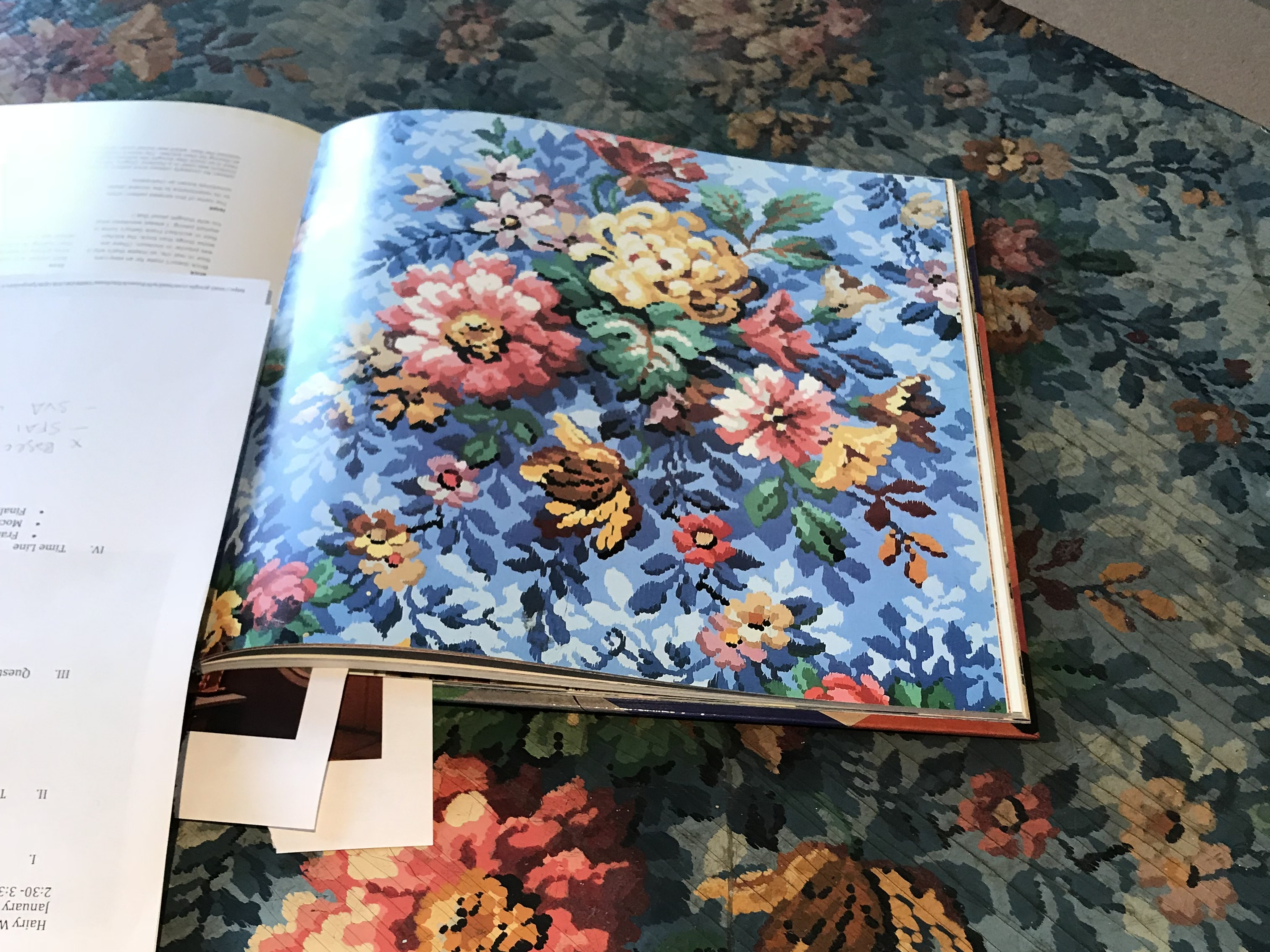 Image from book laid next to matching linoleum on floor