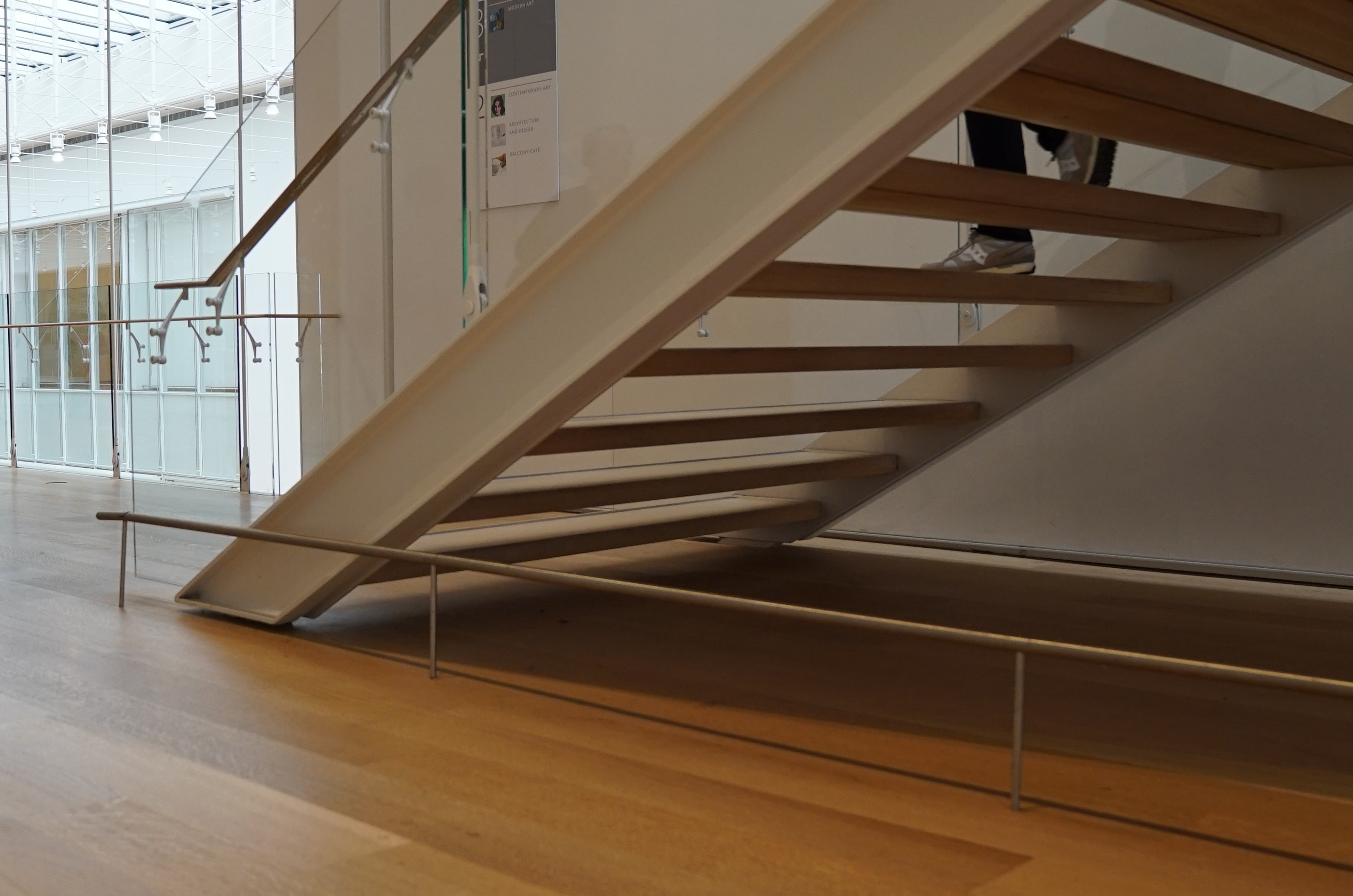 "Staircase in Modern Wing that seems to ""float"" above the floor due to one-inch reveal"