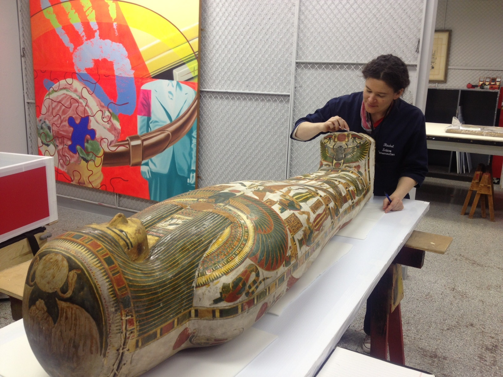 Objects conservator Rachel Sabino inspects both mummies before approving them for travel.