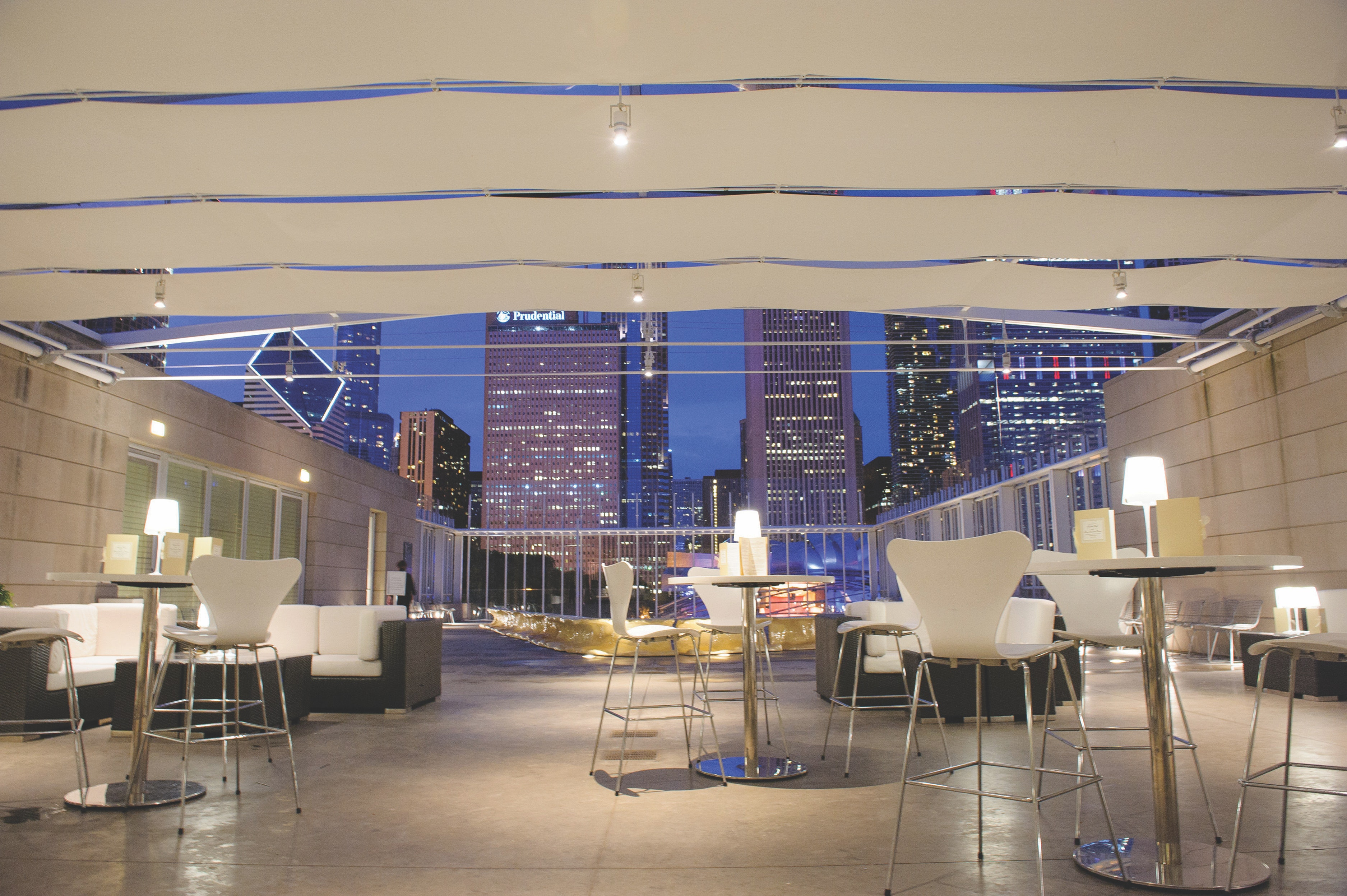 A handful of tables are set up overlooking the Chicago skyline.