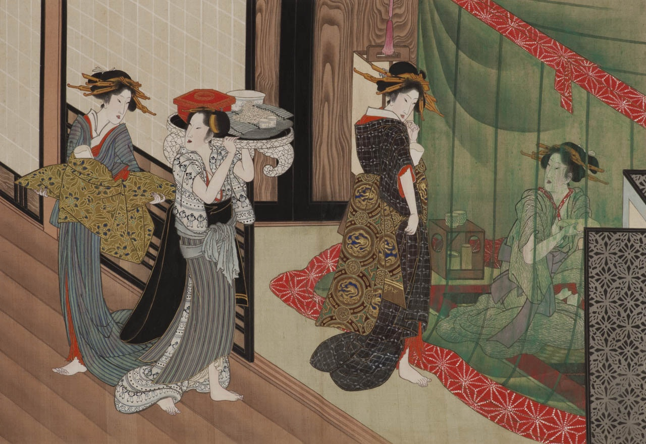 Four women in intricately patterned robes perform pass each other in a Japanese interior.
