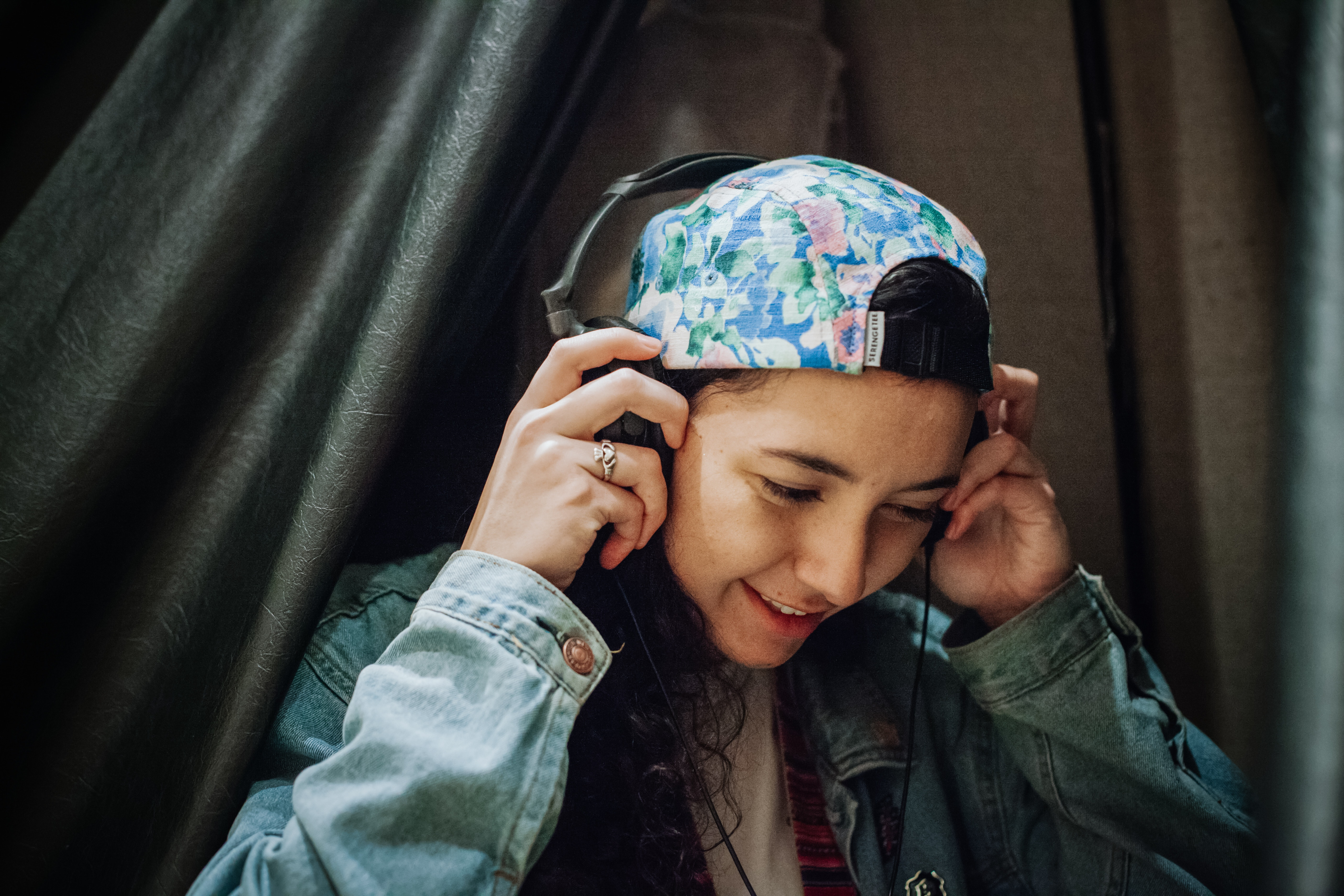 A teen uses headphones in the museum