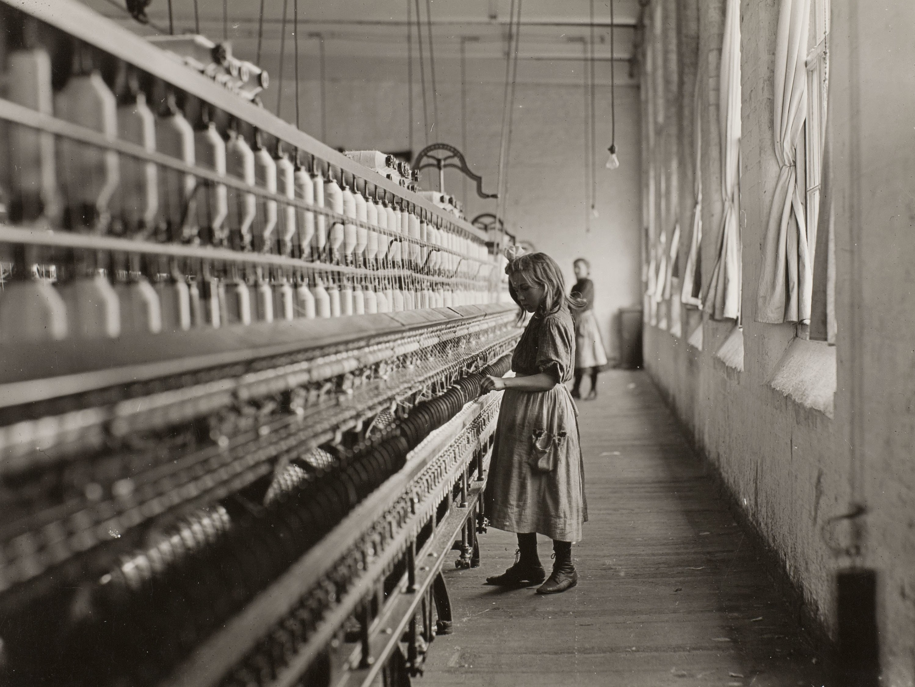 A young girl works in a factory.