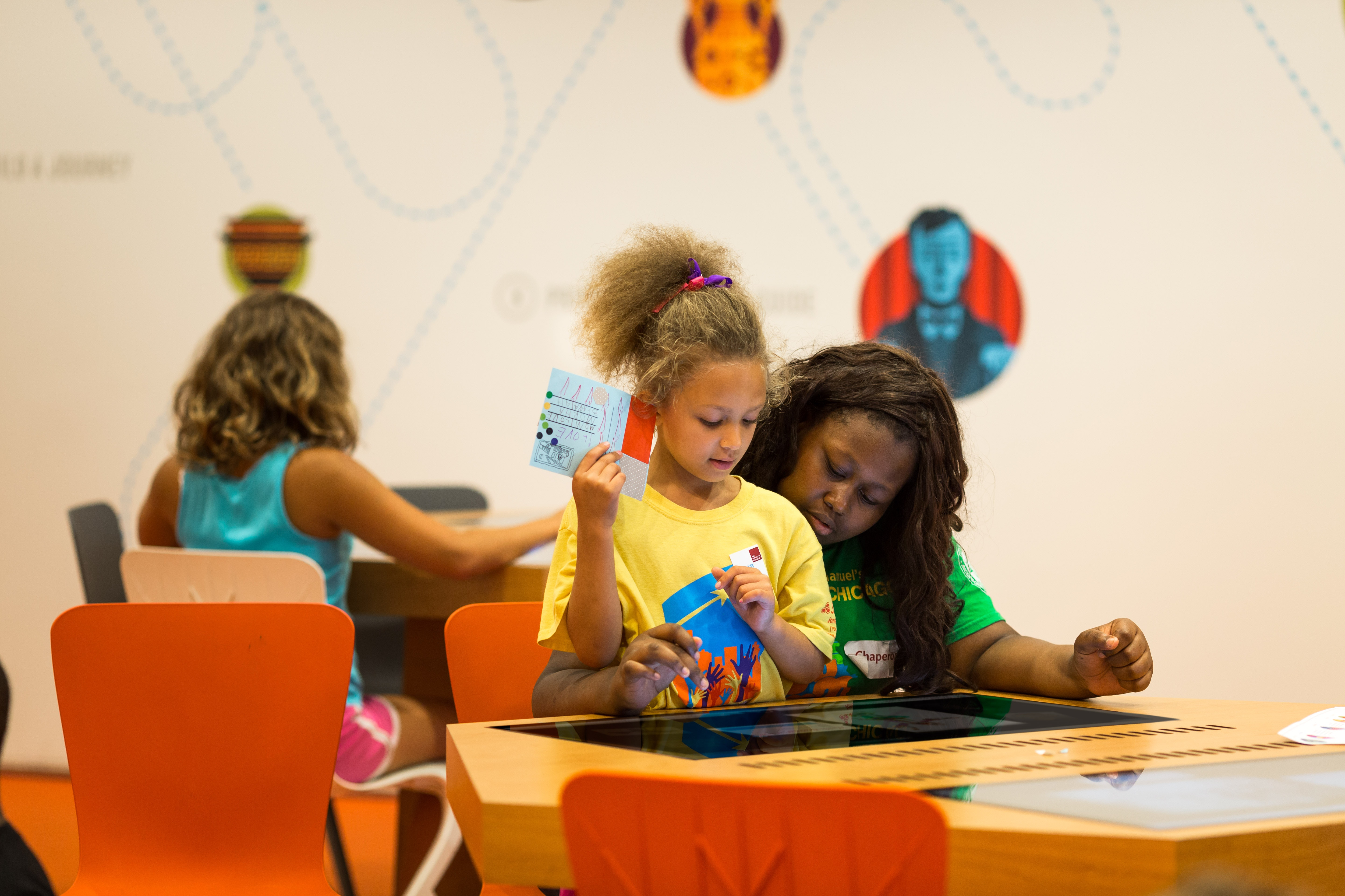 Mother and daughter using the JourneyMaker interactive in the Ryan Learning Center