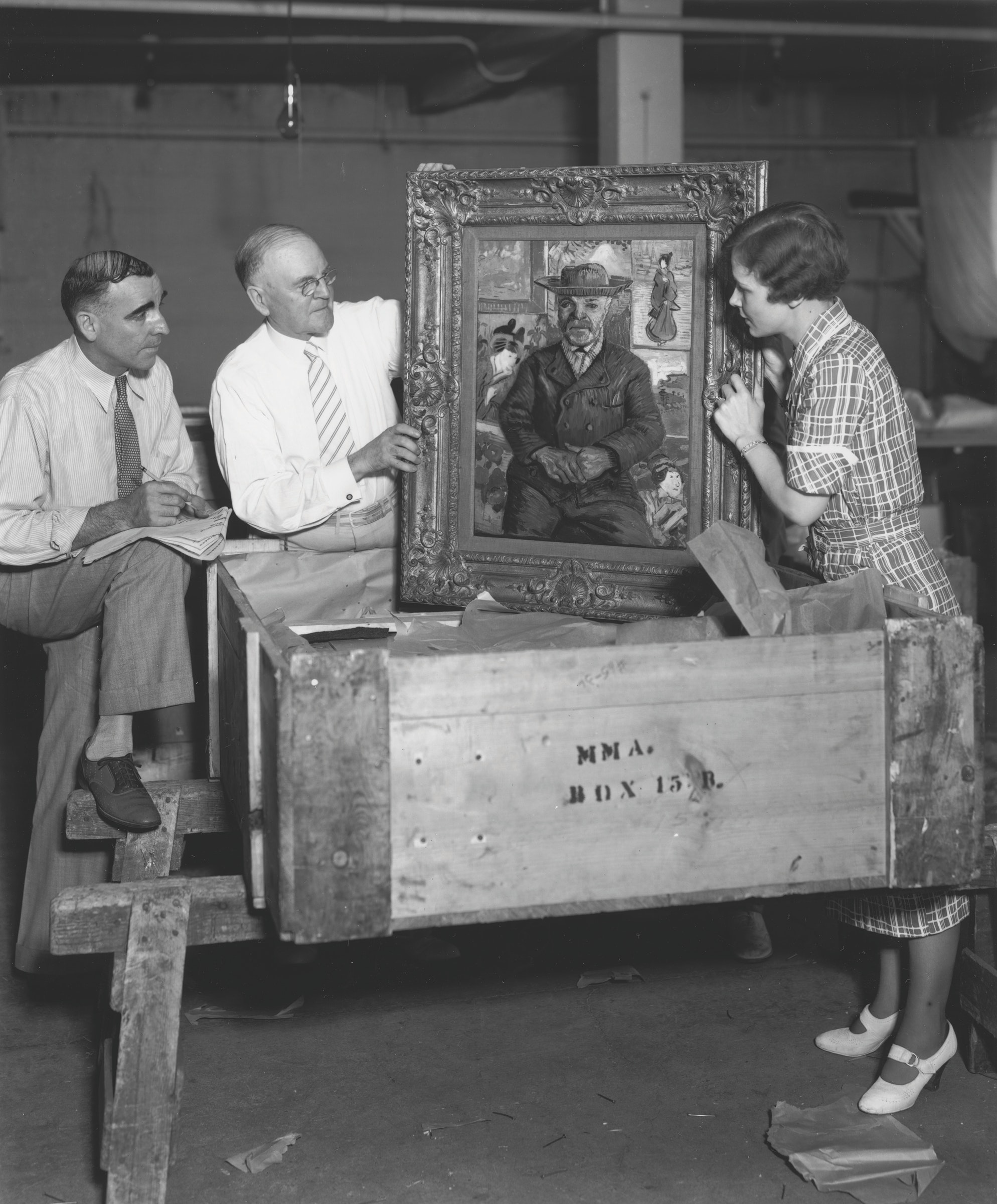 Old photo of painting being uncrated