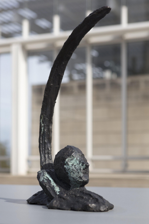 A view of a bronze sculpture in an installation