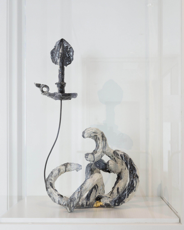 A photo of a sculpture of a candlestick.