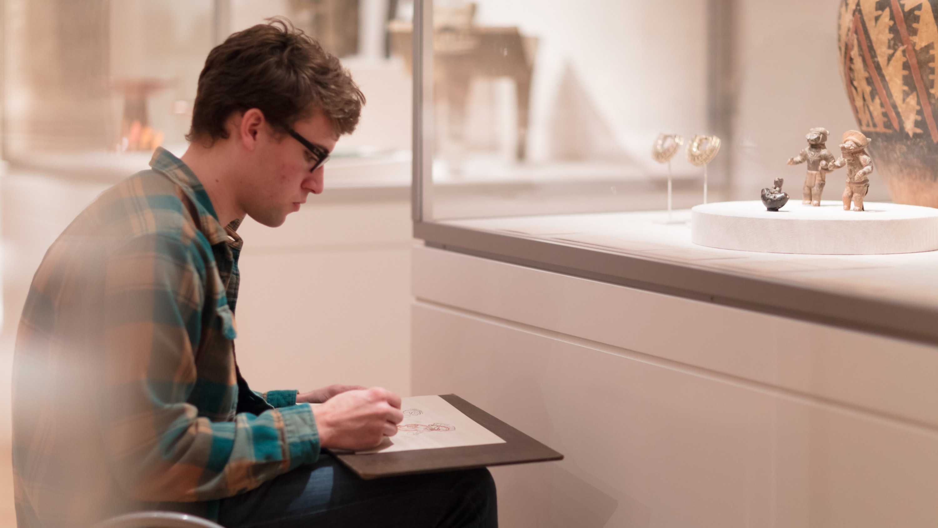 Young man sketching in the galleries