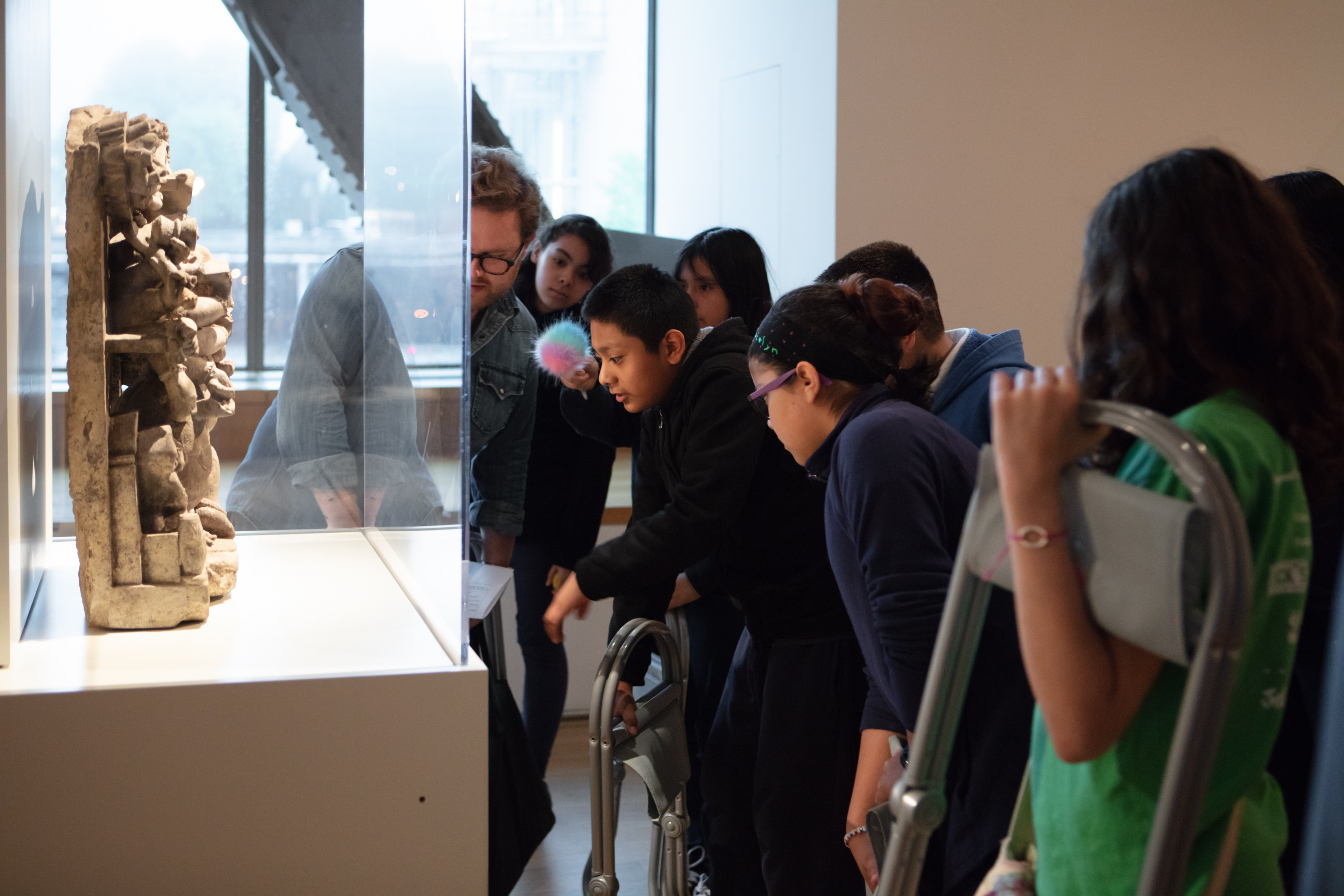 Groups of school kids looking at Asian art