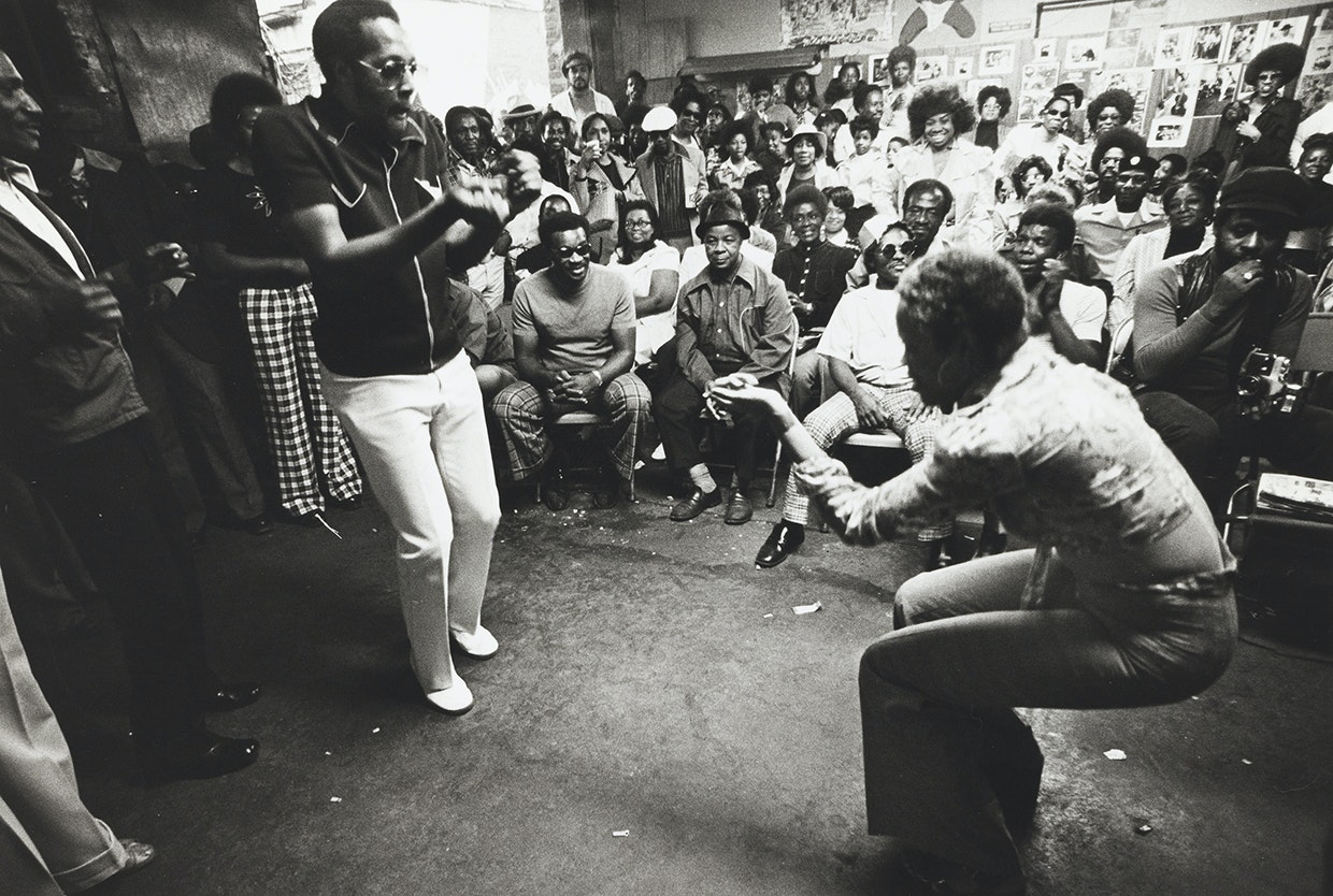 Couple dancing in front of a seated audience in the Garage