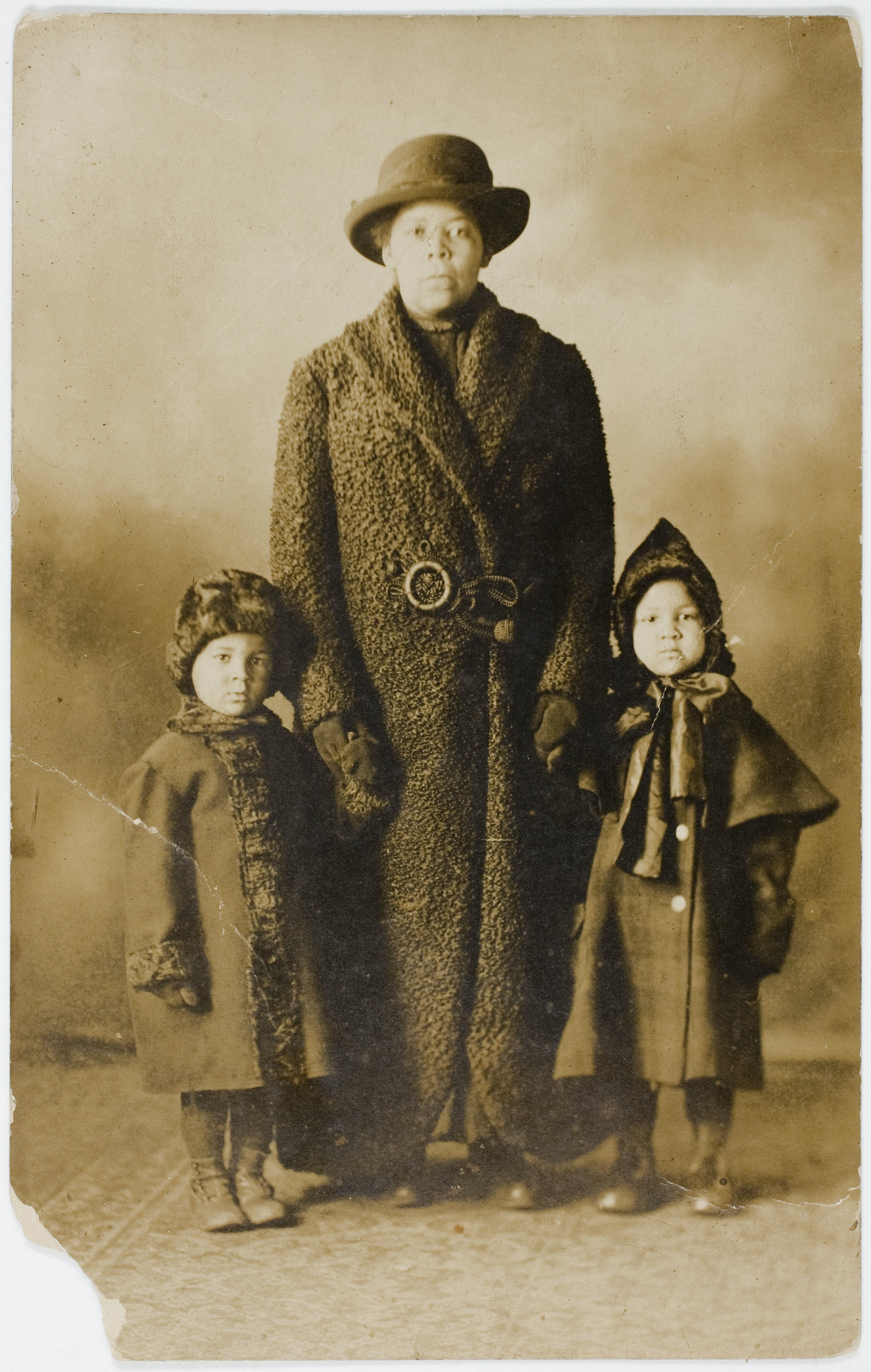 Untitled black woman and two children from Peter Cohen collection