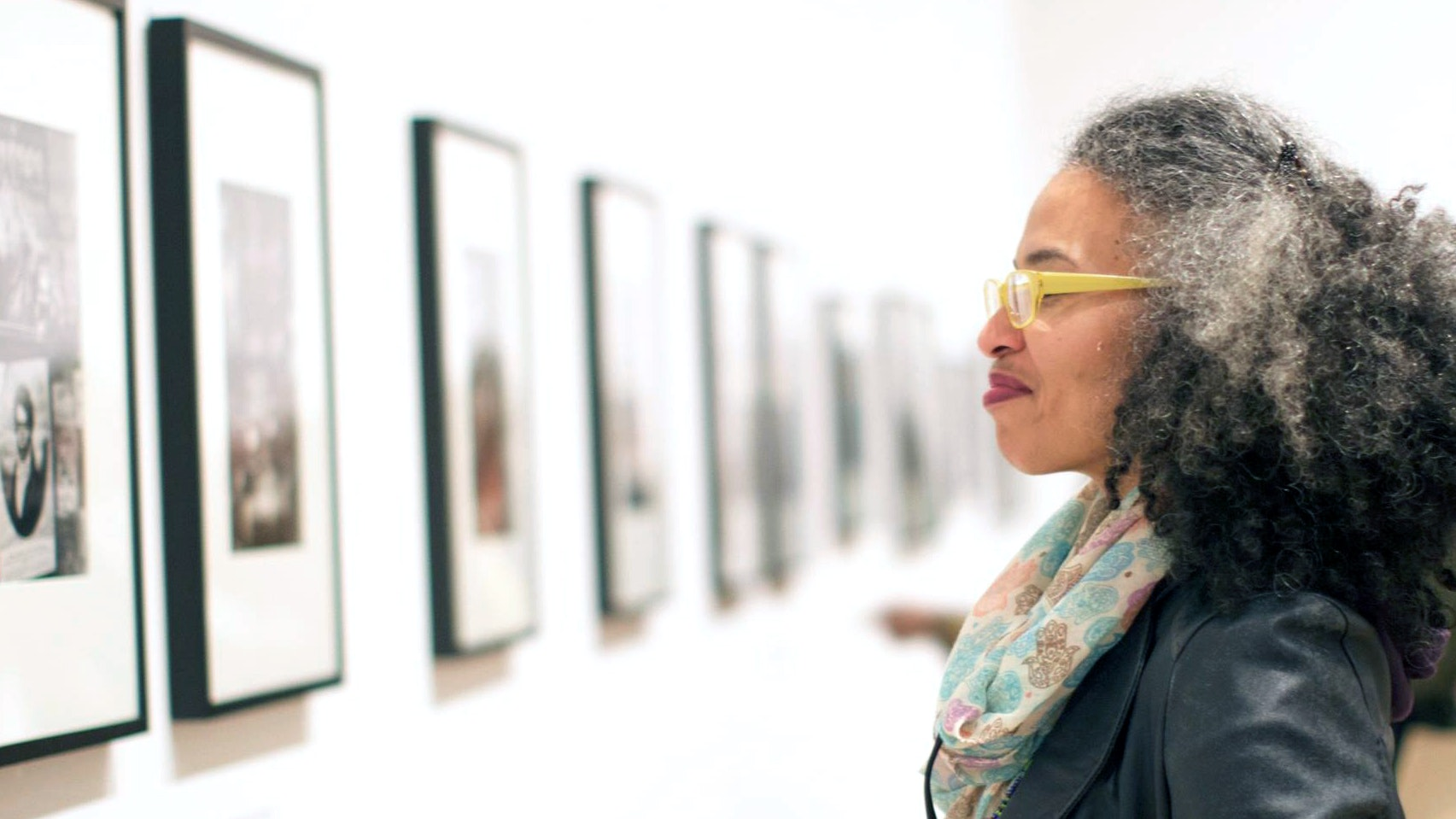 A woman from the Leadership Advisory Committee looks at artwork in the galleries