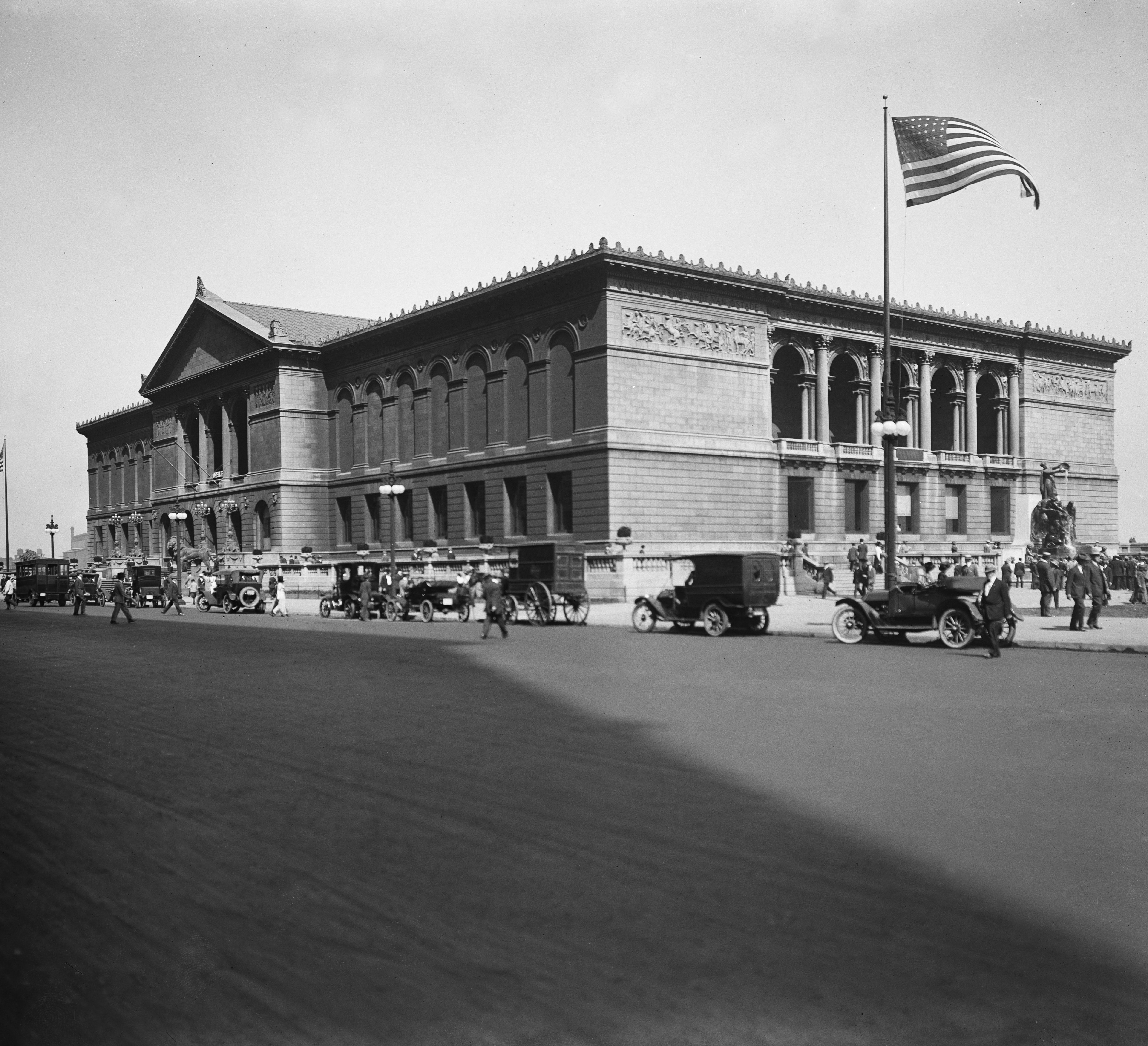 Archival image of an American flag raised in front of the Art Institute of Chicago Michigan Ave. entrace
