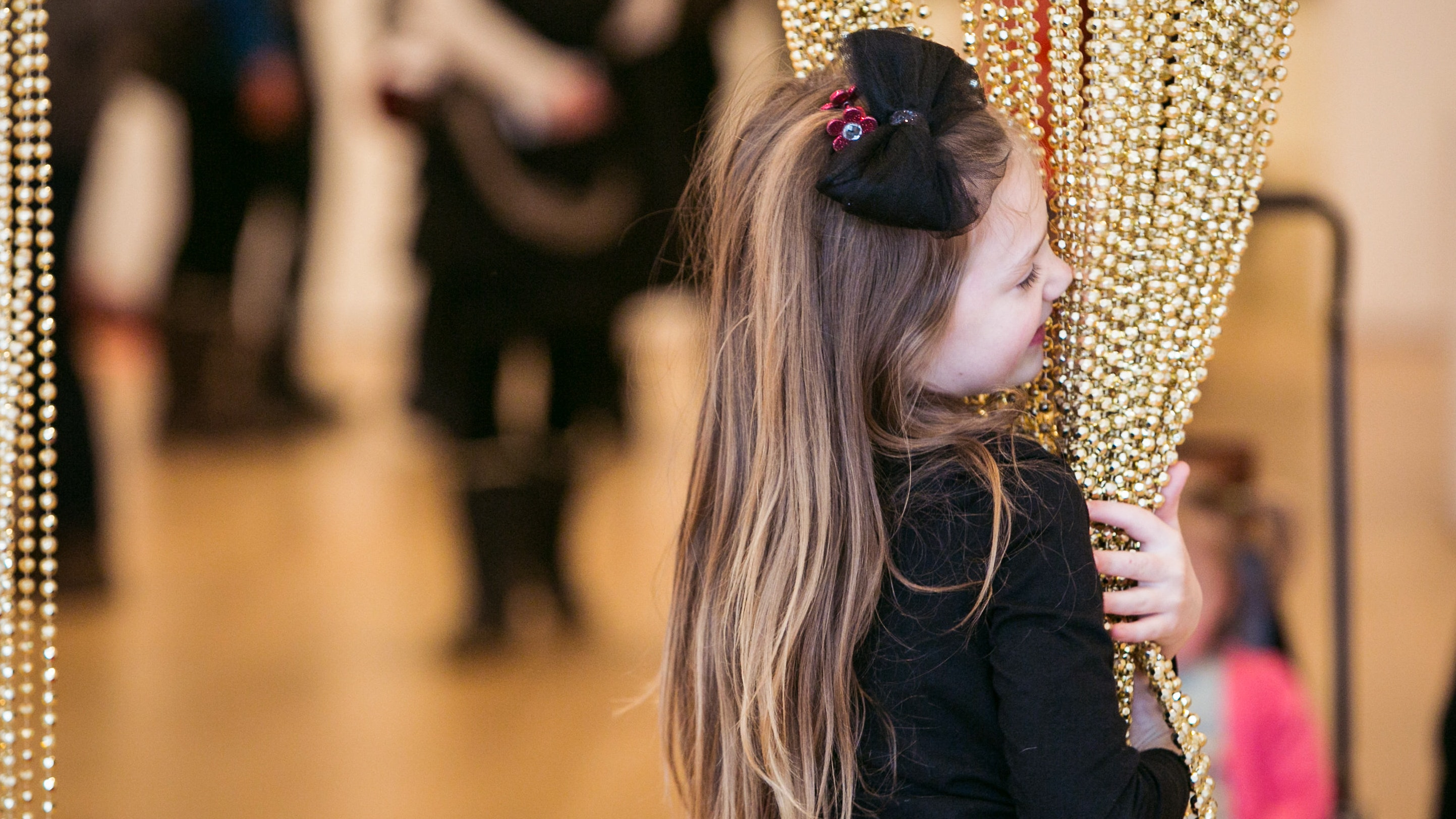 Little girl interacts with a contemporary piece of art