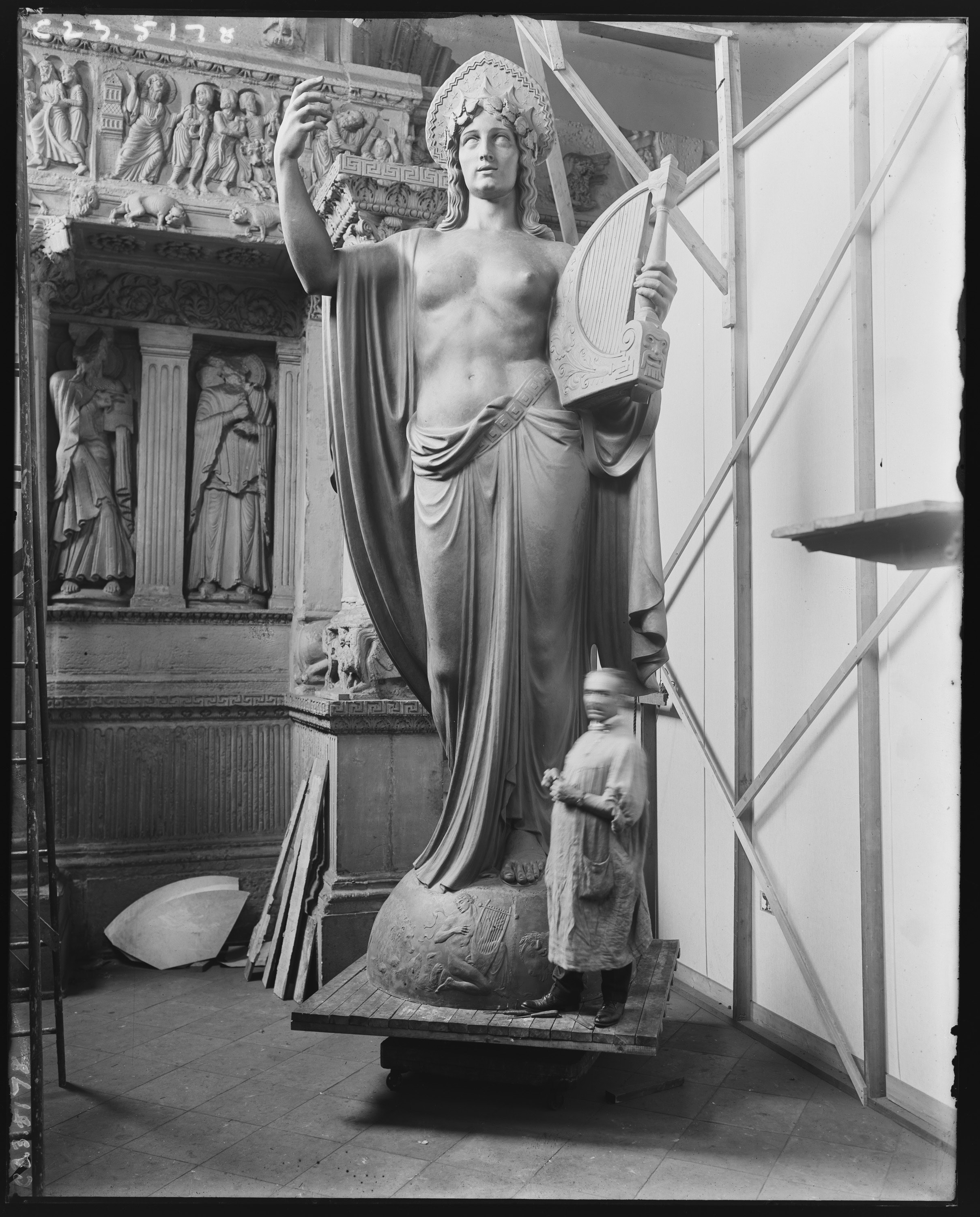Old photo of monumental statue being installed