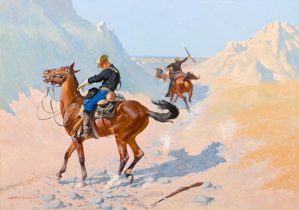 Two men ride brown horses in the desert surrounded by mountains.